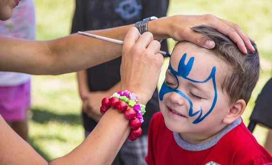 face painting and balloon twister
